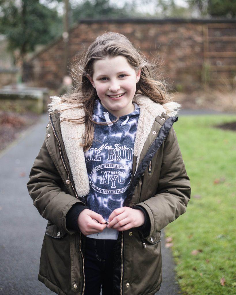 Big sister smiles, colourful Lancashire photographer.