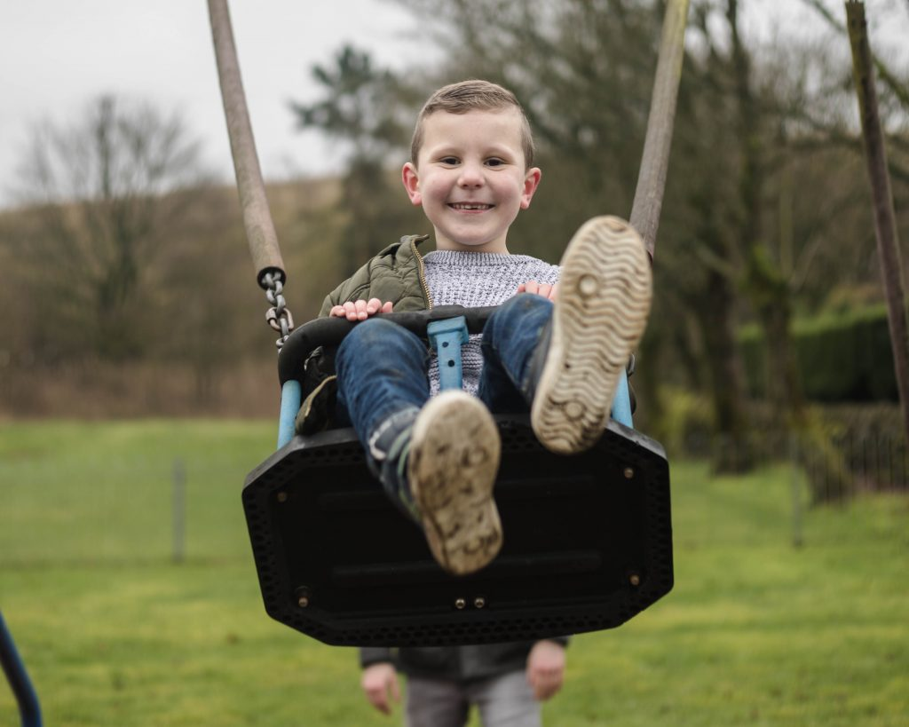 smiles on the swings, family photographer.