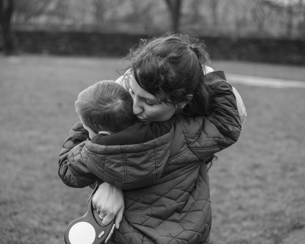 Black and white photograph of mum and son, documentary family photography.