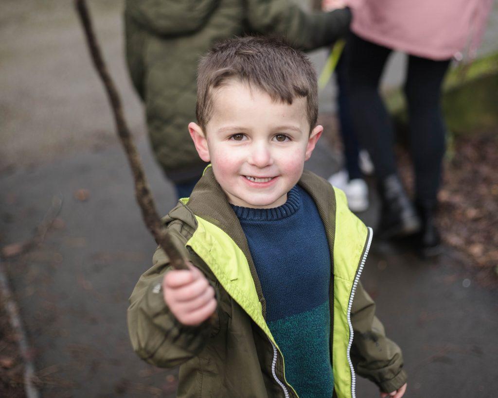Little boy holding a stick