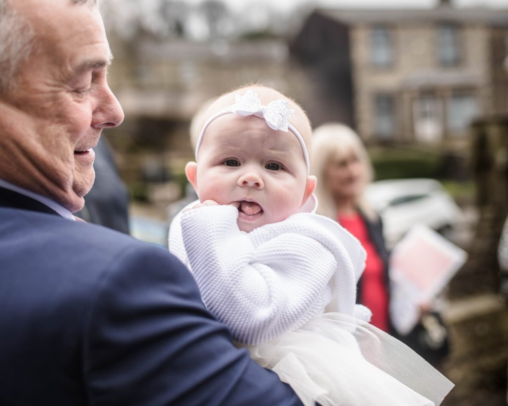 The little girl with her granddad, christening photography.