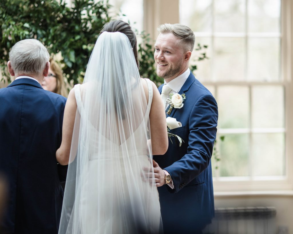 the groom as his bride walks down the aisle, mutton hall wedding.