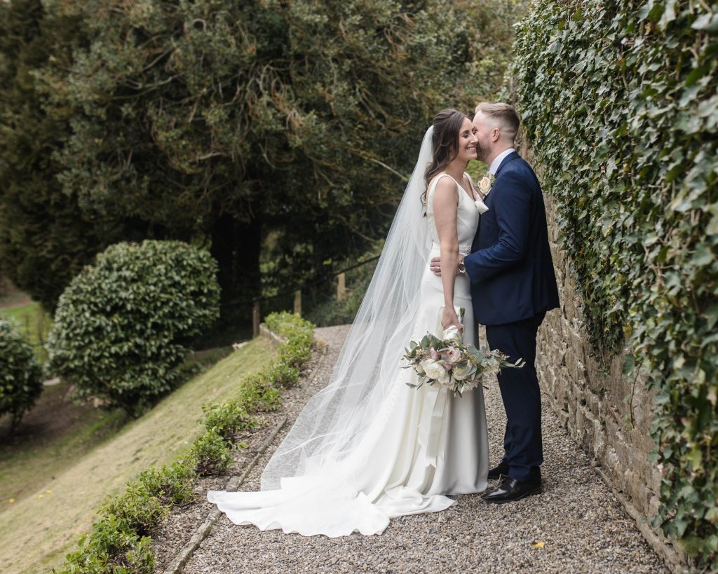the bride and groom kissing the cheek, documentary wedding photography in Lancashire.