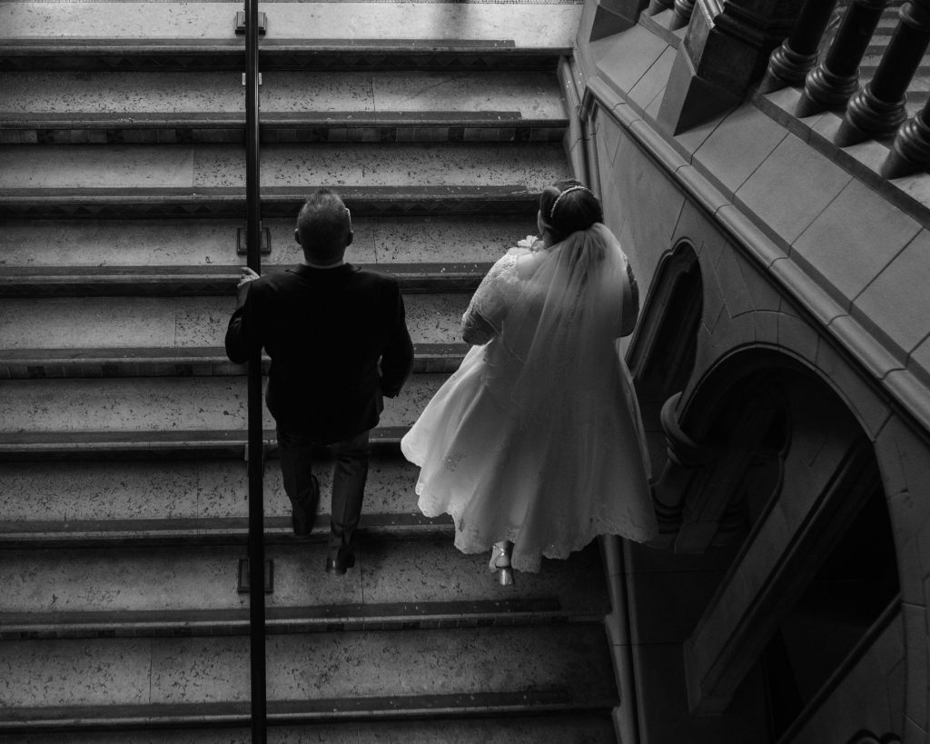 Thebride and her father walking up the stairs in Manchester, wedding photography.