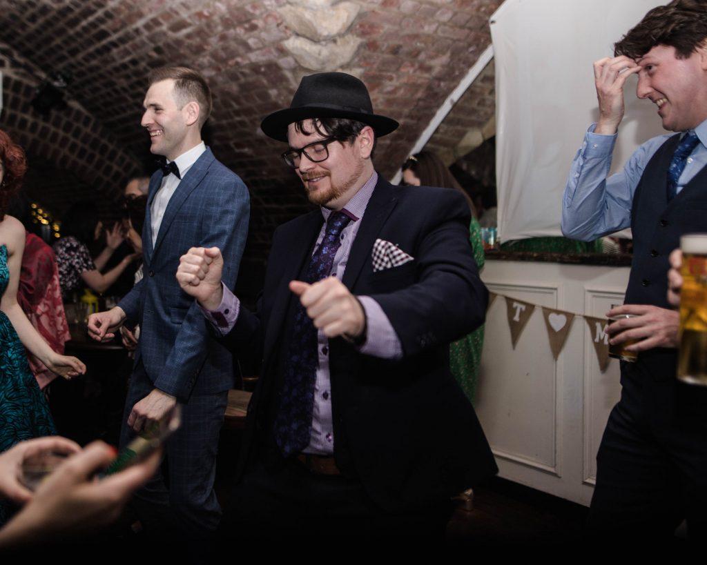 Dancing wedding guests, documentary wedding photography.