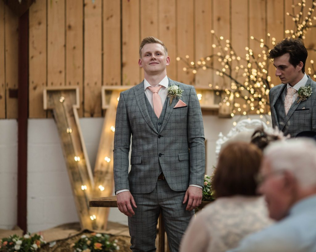 Groom waiting at the alter at the welbeing farm in lancashire