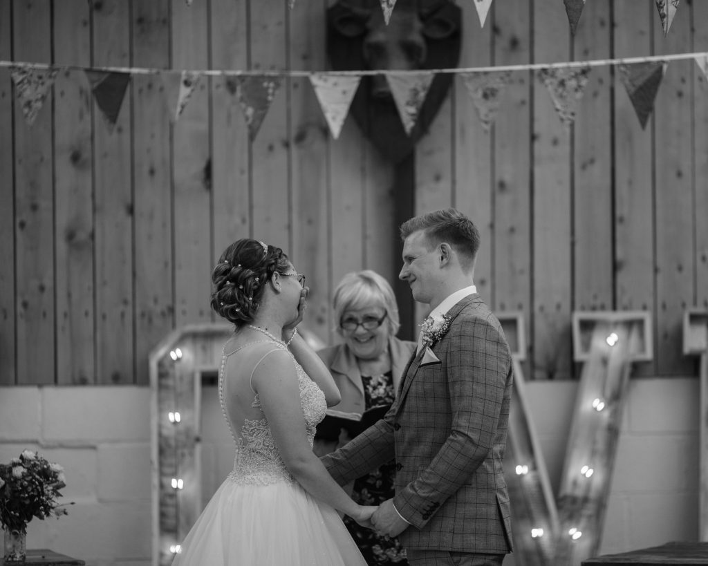 The bride and groom t the end of the alter, Lancashire wedding photography