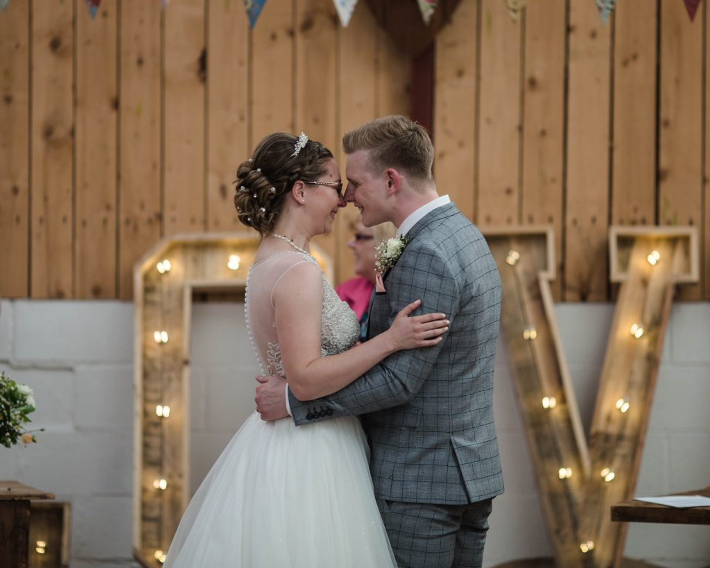 The bride and groom at the alter just before the kiss, colourful wedding photography in lancashire.