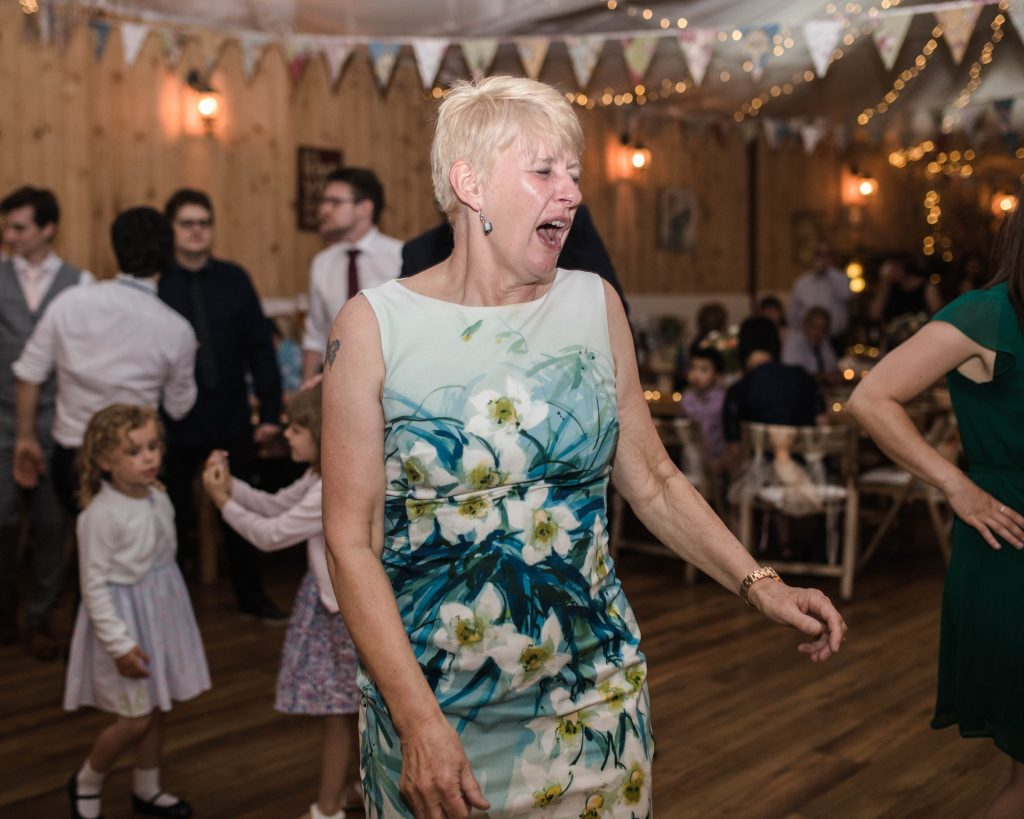 Wedding guests singing and dancing on the dance floor, lancashire wedding photography.