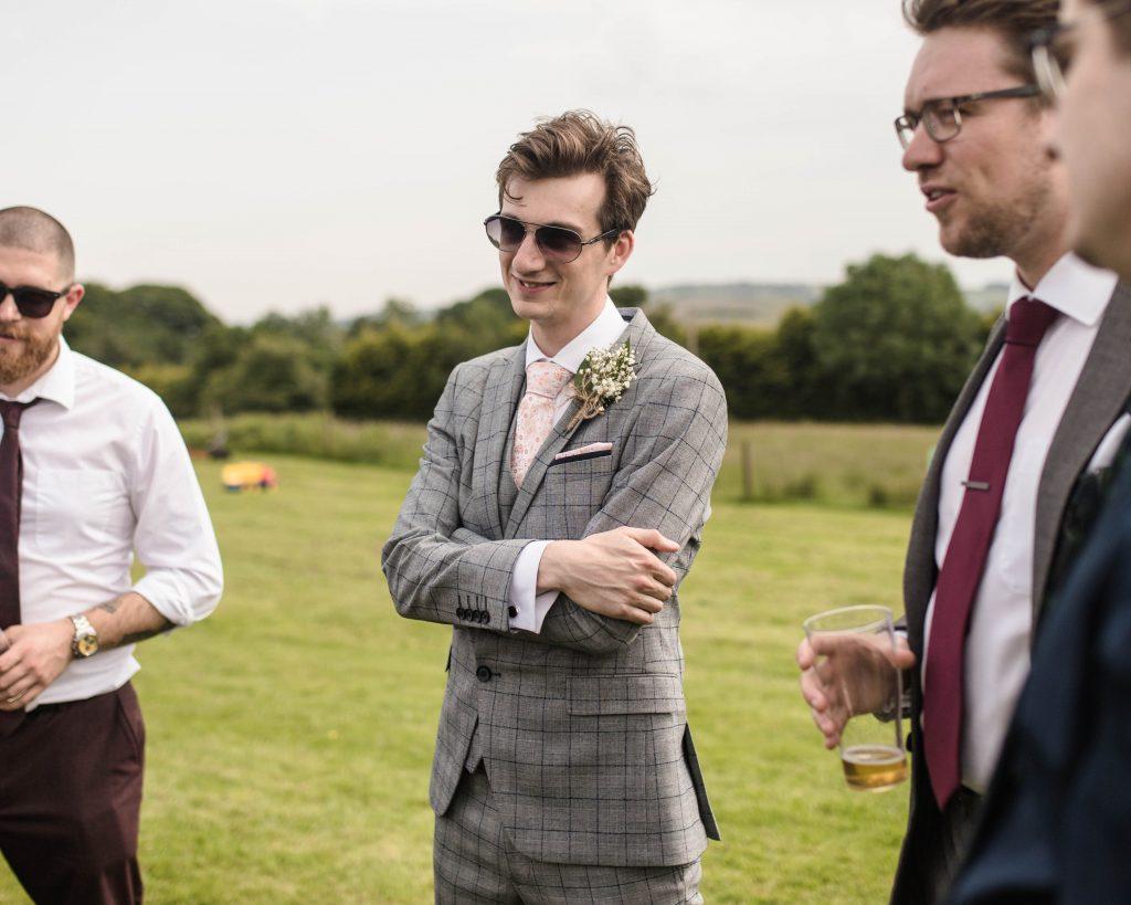 Wedding guest smiling, documentary wedding photography.