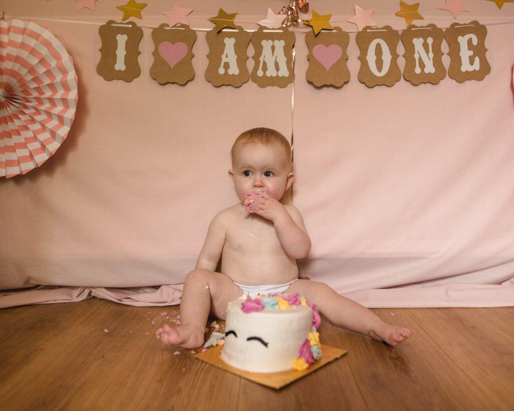 cake smash for baby birthday, creative family photography.