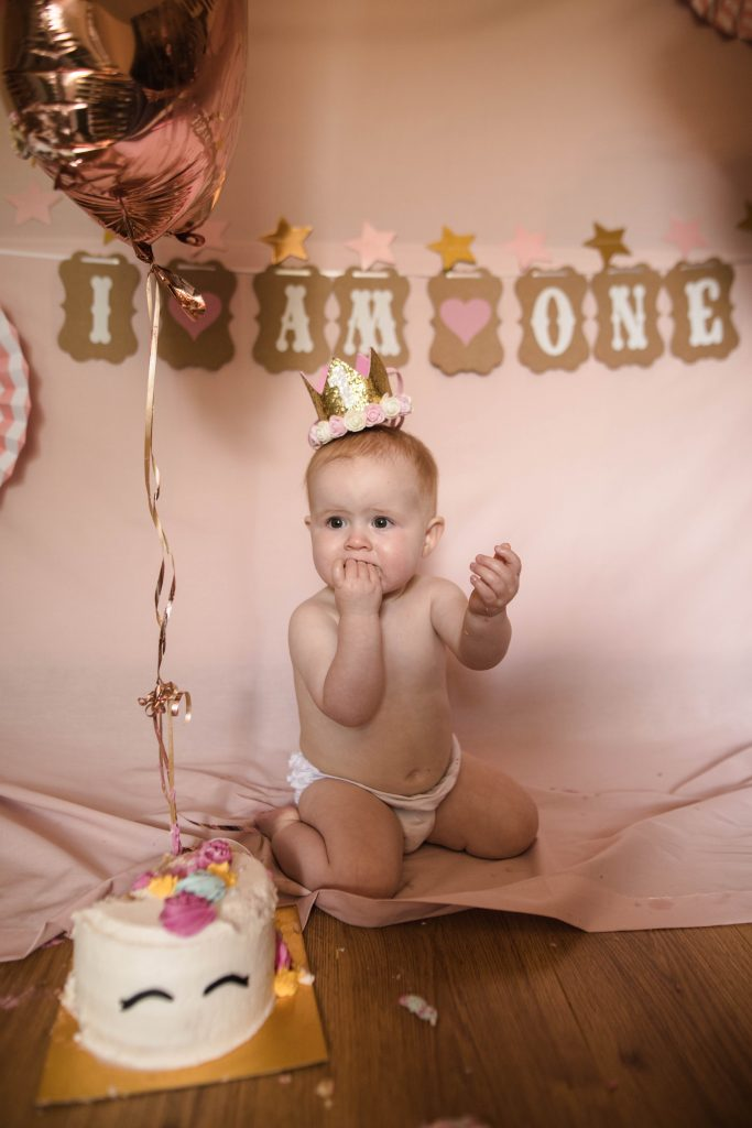 baby eating cake, colourful family photography.