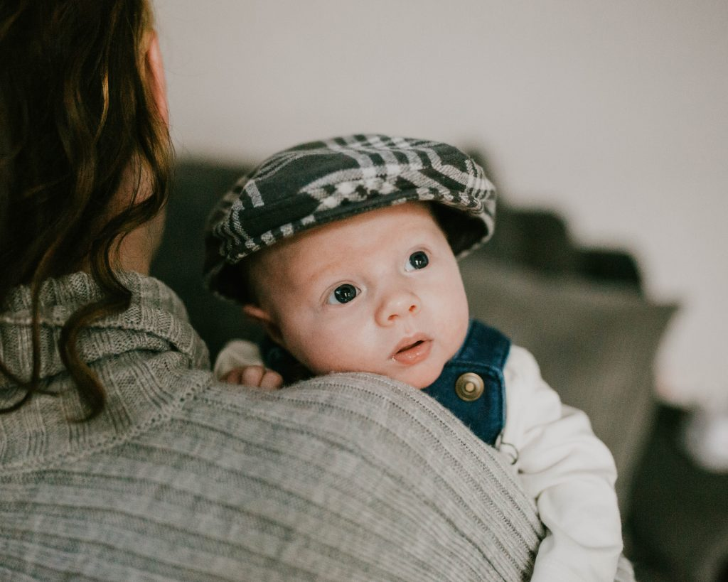 Baby boy being held by his mum, documentary photography in Lancashire. Newborn Lifestyle photoshoot.