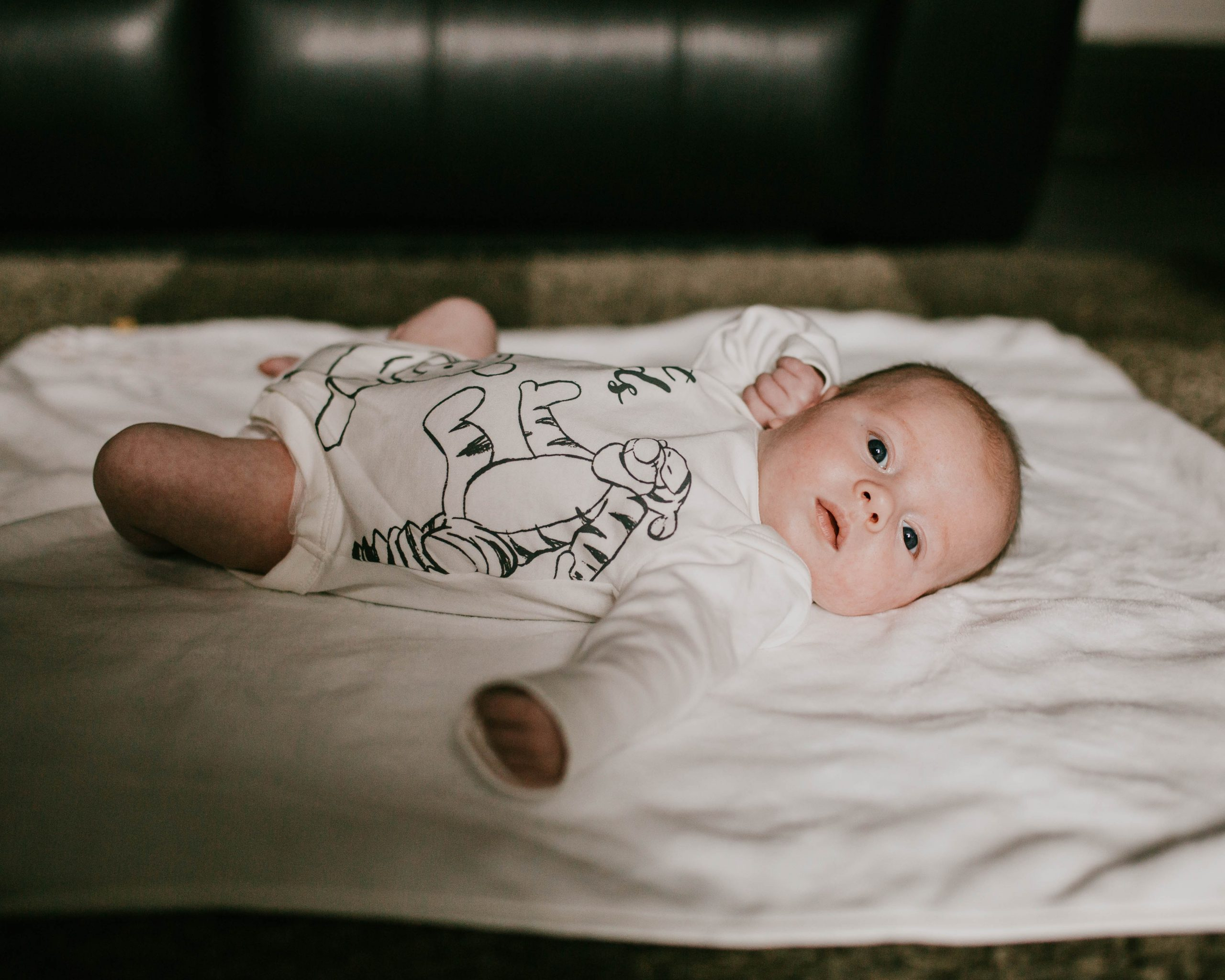 Baby boy laid on the floor, family photography Rossendale