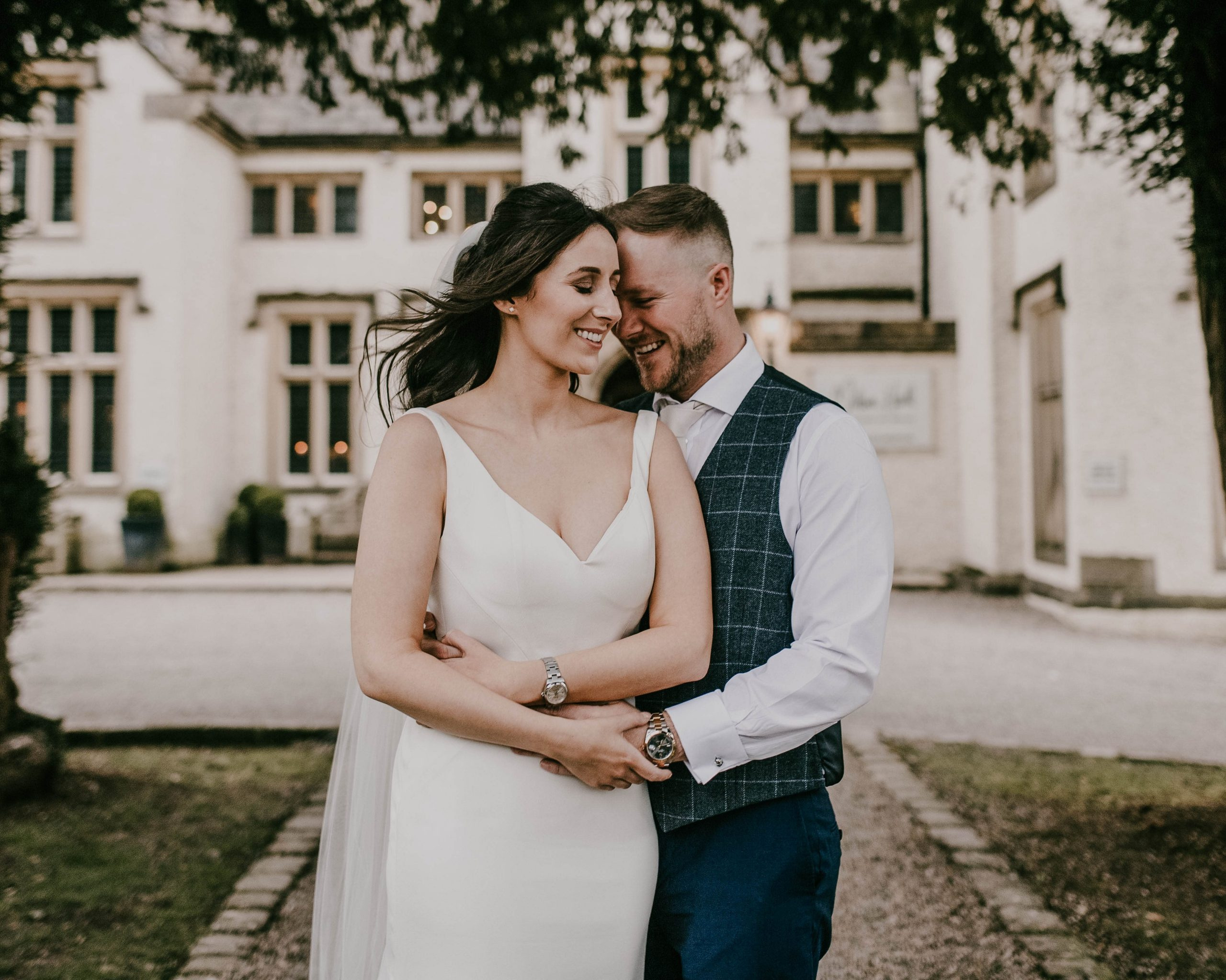 bride and groom outside of mitton hall Clitheroe.