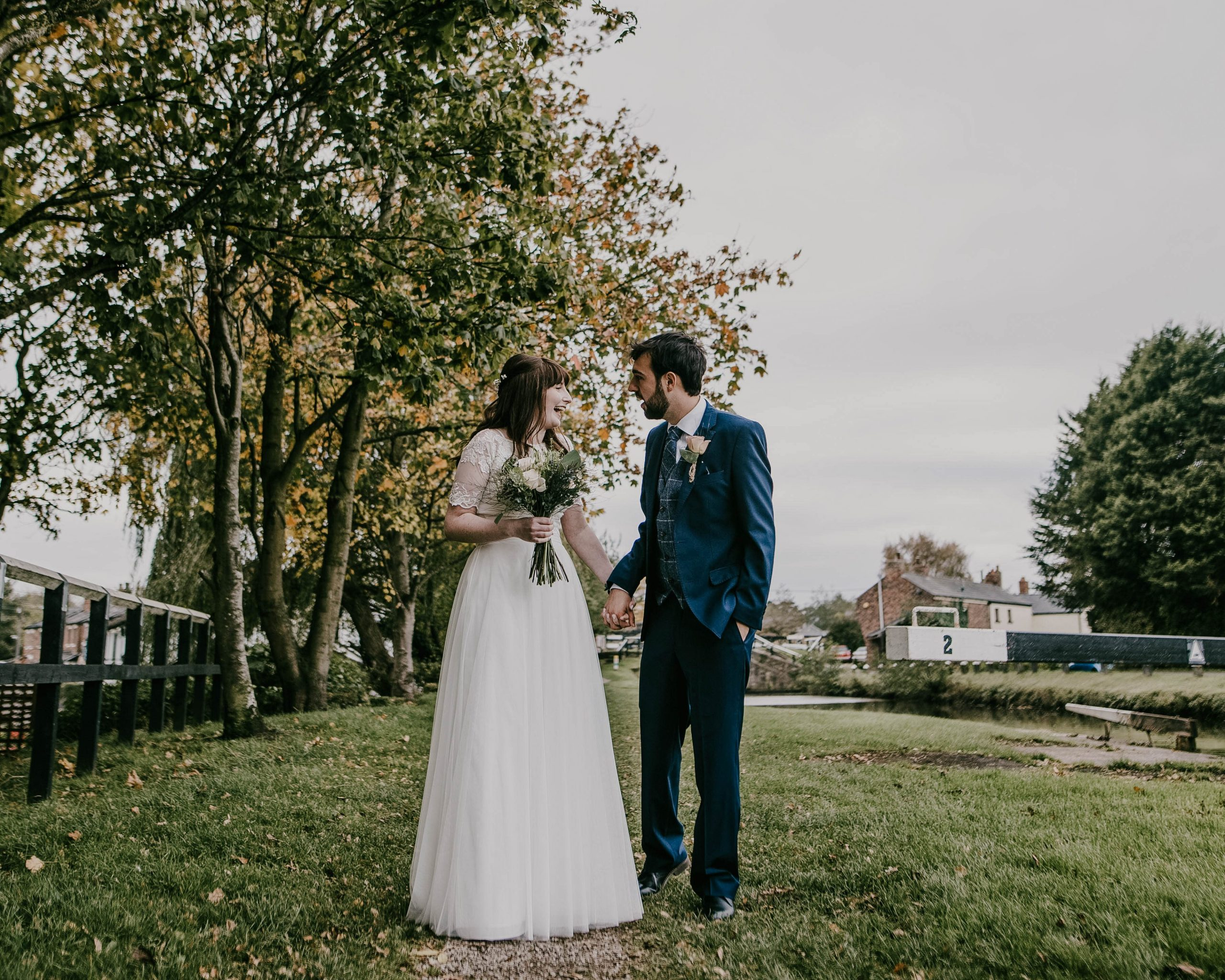 the bride and groom looking at one another, Lancashire Wedding photography