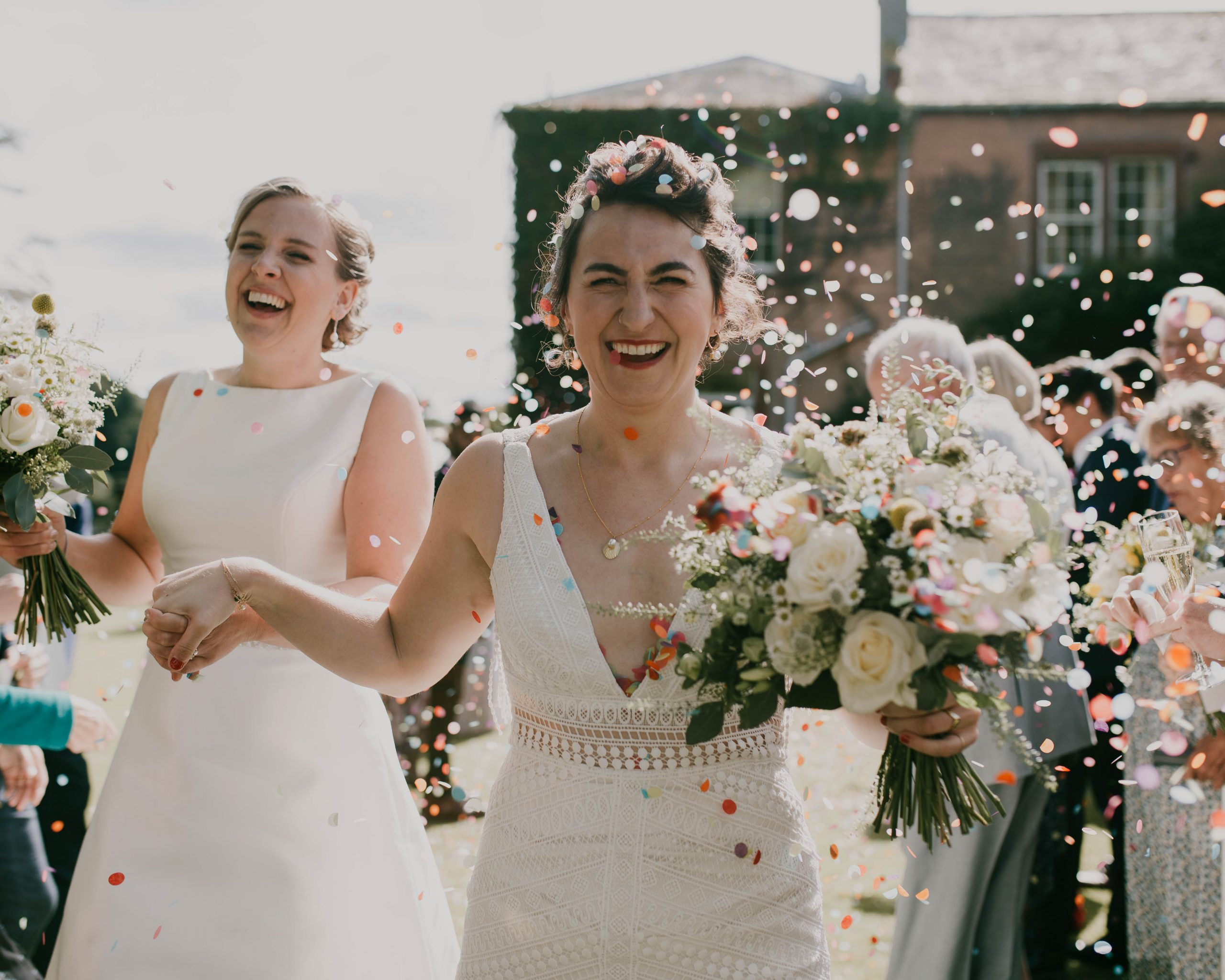 a face full of confetti, Low house wedding in the Lake District, outdoor wedding