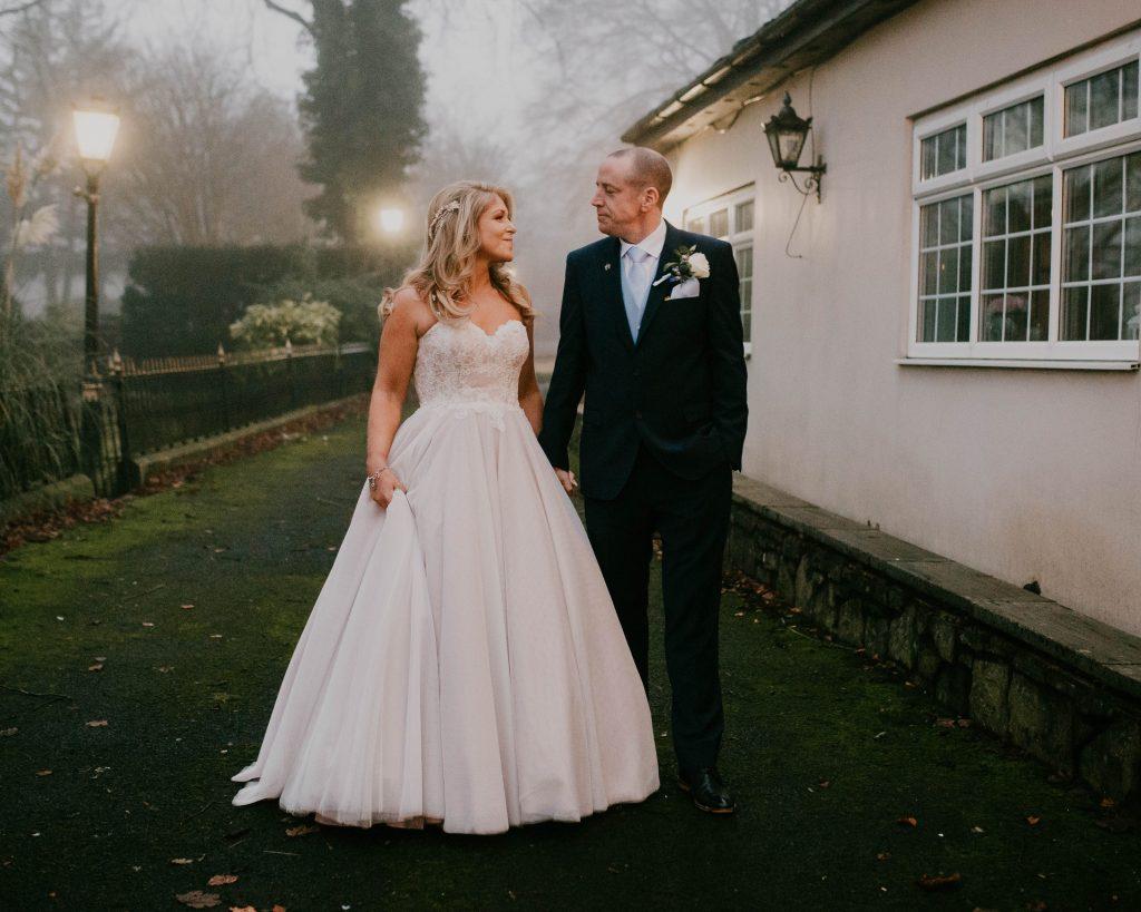 the bride and groom walking, creative wedding photography